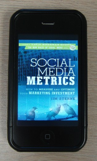 Social Media Metrics book on an iPhone